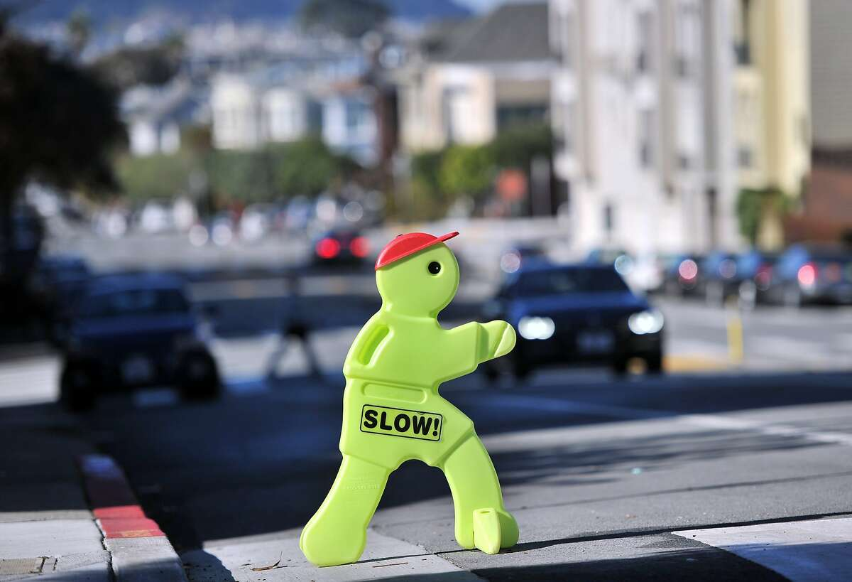 A sign signals drivers to slow down near an intersection where Soren Kim's 3-year-old daughter Grace was struck by a car in San Francisco on November 13, 2015. Since Grace has been hospitalized, three other people - including two 12-year-old boys - have been seriously injured on San Francisco streets.