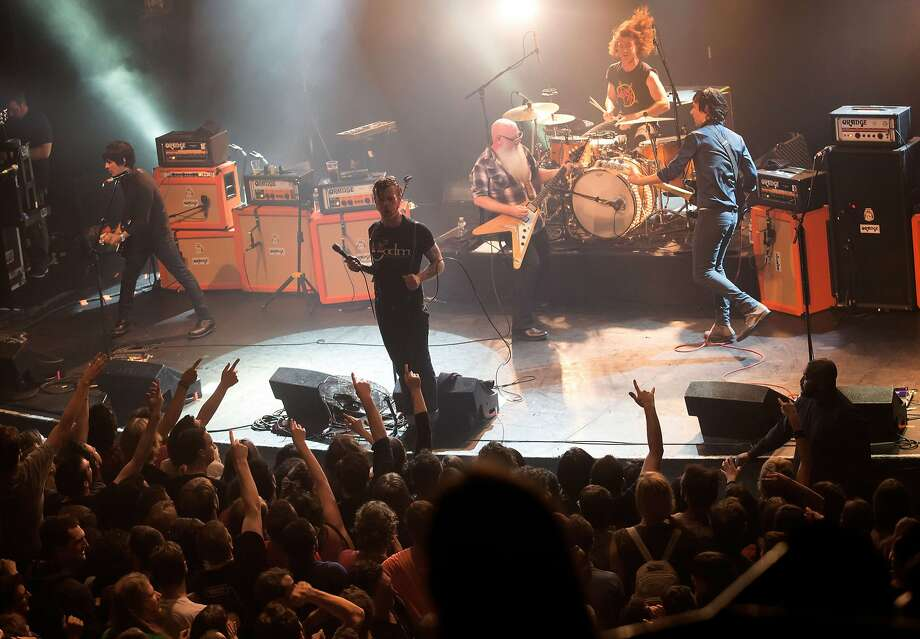 "American rock group Eagles of Death Metal perform on stage on November 13, 2015 at the Bataclan concert hall in Paris, few moments before four men armed with assault rifles and shouting ""Allahu akbar"" (""God is great!"") stormed into the venue. Islamic State jihadists on November 14, 2015 claimed a series of coordinated attacks by gunmen and suicide bombers in Paris that killed at least 128 people in scenes of carnage at the Bataclan, restaurants and the national stadium.   AFP PHOTO / ROCK&FOLK / MARION RUSZNIEWSKIMarion Ruszniewski/AFP/Getty Images Photo: Marion Ruszniewski, AFP / Getty Images"