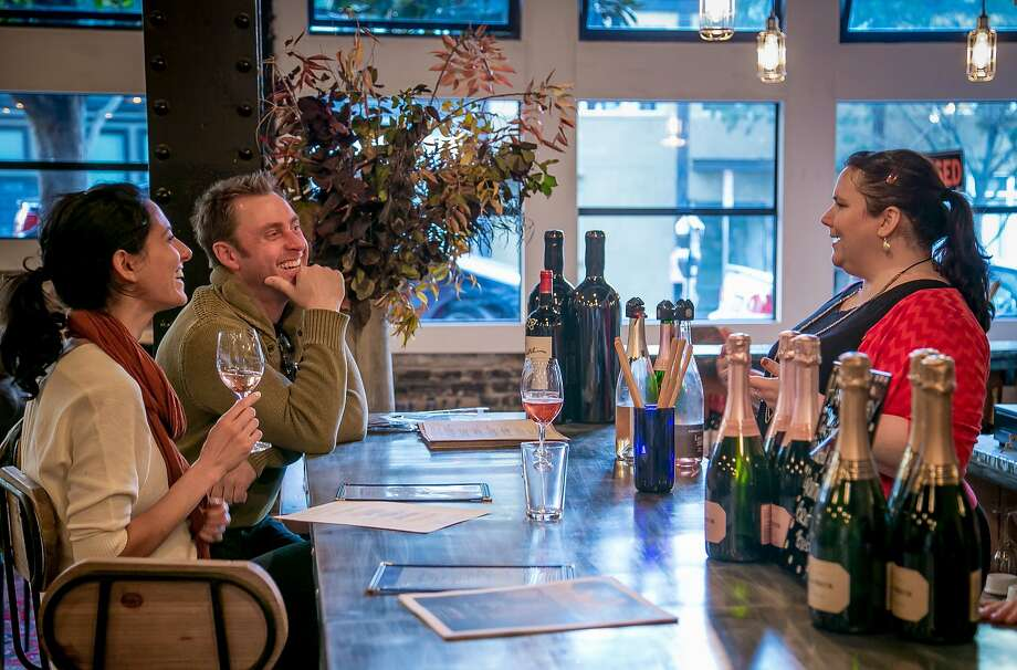 Manager Katie Guiney talks with a couple at the Maritime Wine Tasting Studio in San Francisco. Photo: John Storey, Special To The Chronicle