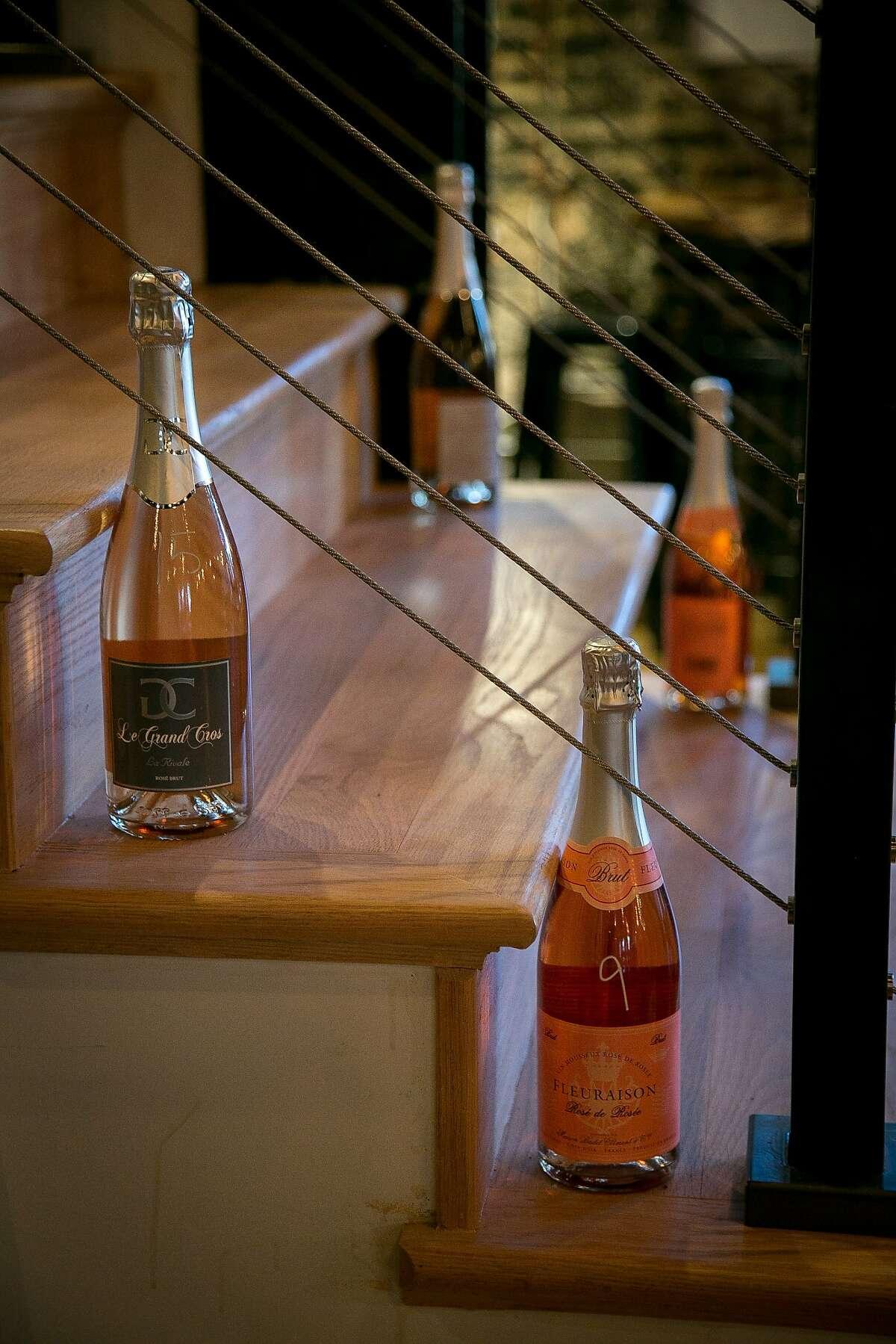 Bottles of wine for sale on the stairway of Maritime Wine Tasting Studio in S.F.