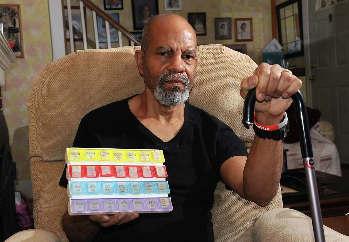 Ken Thurman, who is living with Parkinson's disease, holds his box of medications in his home on Tuesday, Nov. 10, 2015 in Schenectady, N.Y. (Lori Van Buren / Times Union)