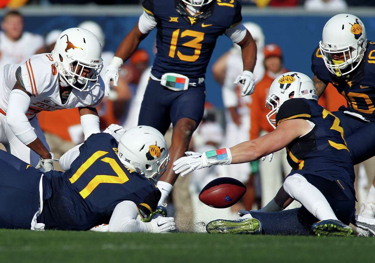 MORGANTOWN, WV - NOVEMBER 14: Justin Arndt #30 of the West Virginia Mountaineers recovers the fumble on a kick return in the second half during the game against the Texas Longhorns on November 14, 2015 at Mountaineer Field in Morgantown, West Virginia.