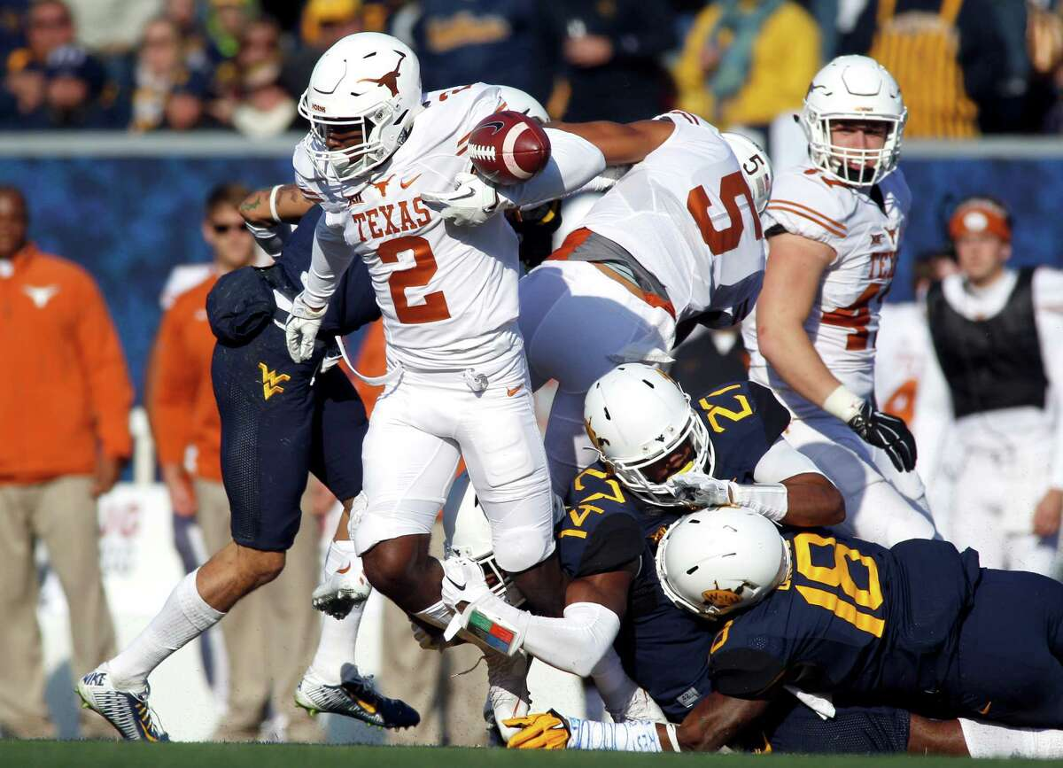 MORGANTOWN, WV - NOVEMBER 14: Kris Boyd #2 of the Texas Longhorns fumbles on a kick return in the second half against against the West Virginia Mountaineers during the game on November 14, 2015 at Mountaineer Field in Morgantown, West Virginia.