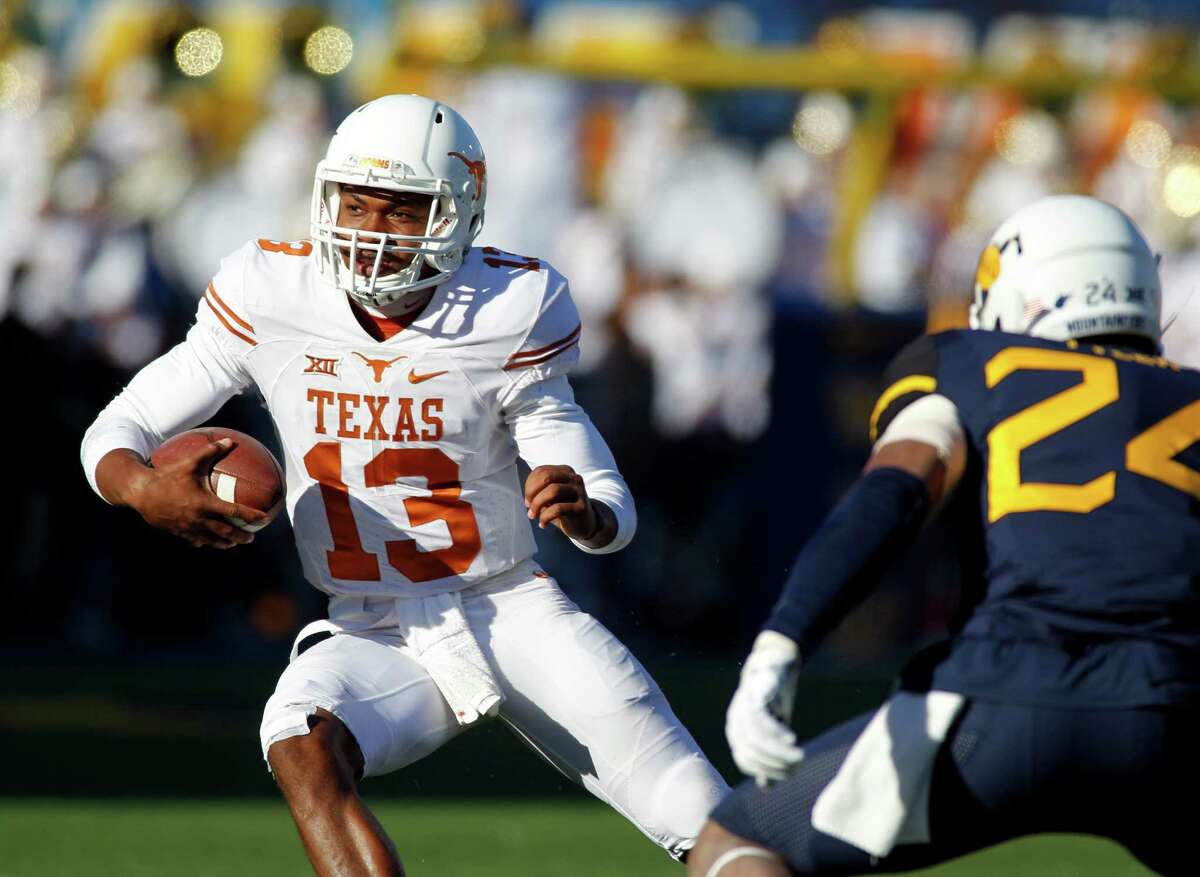 MORGANTOWN, WV - NOVEMBER 14: Jerrod Heard #13 of the Texas Longhorns rushes against Jeremy Tyler #24 of the West Virginia Mountaineers during the game on November 14, 2015 at Mountaineer Field in Morgantown, West Virginia.