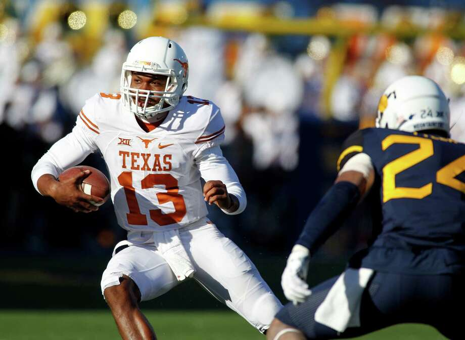 MORGANTOWN, WV - NOVEMBER 14:  Jerrod Heard #13 of the Texas Longhorns rushes against Jeremy Tyler #24 of the West Virginia Mountaineers during the game on November 14, 2015 at Mountaineer Field in Morgantown, West Virginia. Photo: Justin K. Aller, Getty Images / 2015 Getty Images