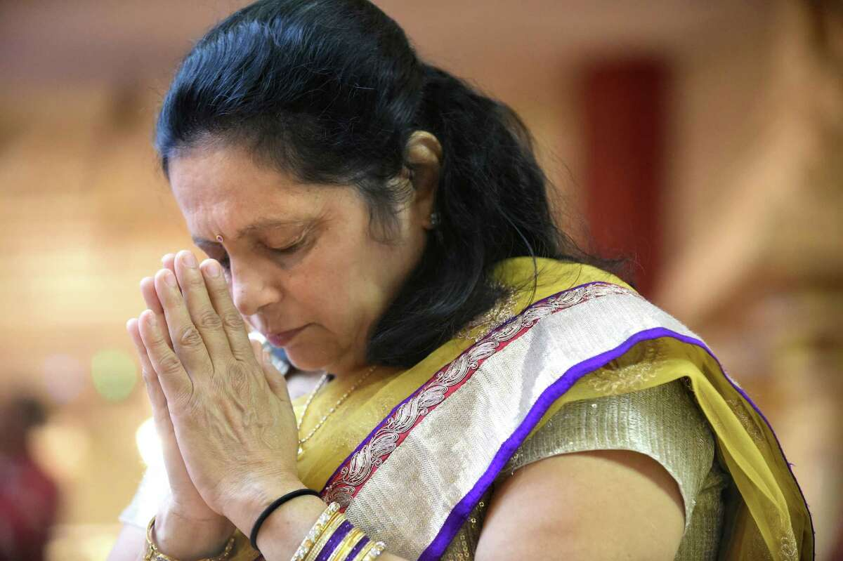 Sujuta Shah prays during the Grand Diwali Celebration on Saturday, Nov. 14, 2015, at the Hindu Temple Society in Loudonville, N.Y. (Cindy Schultz / Times Union)