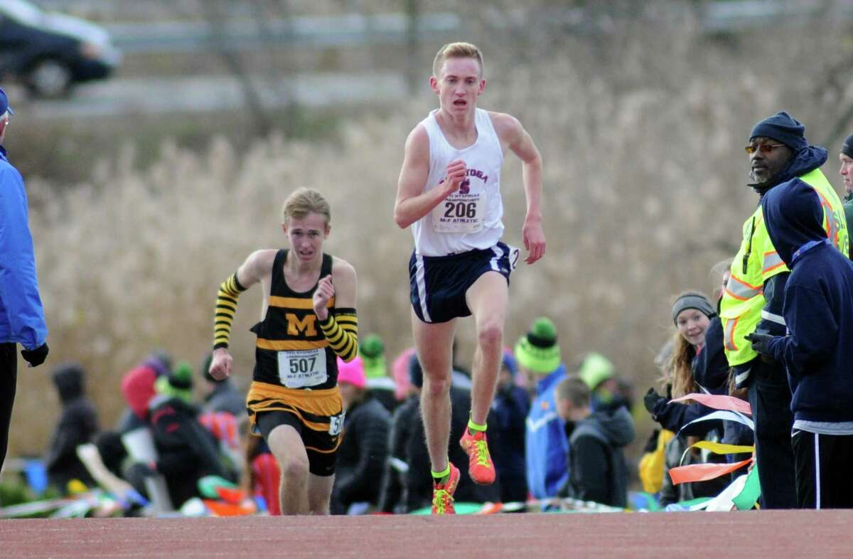 Saratoga's Aiden Tooker heads to the line for a second place finish in the Boy's Class A New York state high school cross country championships on Saturday Nov.14, 2015 in Central Valley, N.Y. (Michael P. Farrell/Times Union)