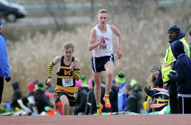 Saratoga's Aiden Tooker heads to the line for a second place finish in the Boy's Class A New York state high school cross country championships on Saturday Nov.14, 2015 in Central Valley, N.Y.  (Michael P. Farrell/Times Union) Photo: Michael P. Farrell / 00034186A