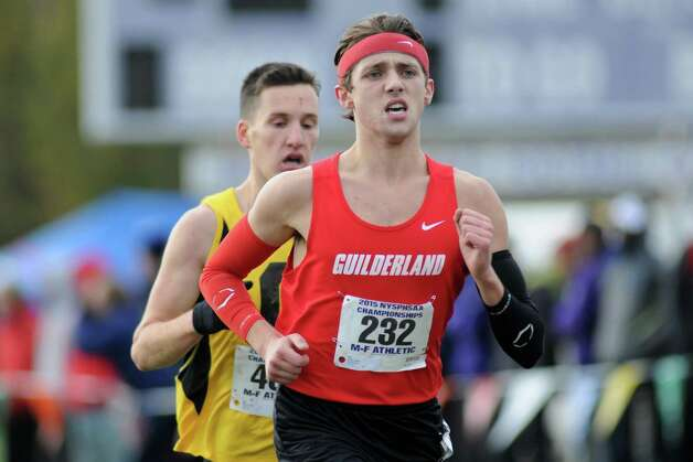Guilderland's Noah Carey heads to the line for a fourth place finish in the Boy's Class A New York state high school cross country championships on Saturday Nov.14, 2015 in Central Valley, N.Y.  (Michael P. Farrell/Times Union) Photo: Michael P. Farrell / 00034186A