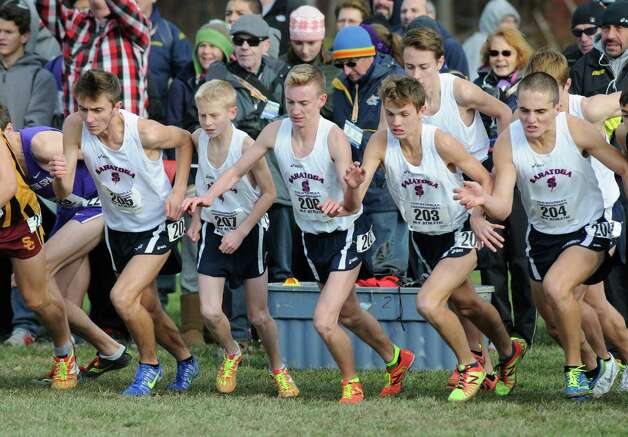 The Saratoga team breaks from the starting line during the Boy's Class A New York state high school cross country championships on Saturday Nov.14, 2015 in Central Valley, N.Y.  (Michael P. Farrell/Times Union) Photo: Michael P. Farrell / 00034186A