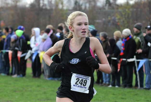 Saratoga's Kelsey Chmeil heads to the line for a third place finish in the Girl's Class A New York state high school cross country championships on Saturday Nov.14, 2015 in Central Valley, N.Y.  (Michael P. Farrell/Times Union) Photo: Michael P. Farrell / 00034186A