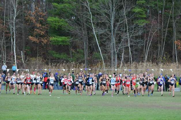 Runners break from the starting line during the Girl's Class A New York state high school cross country championships on Saturday Nov.14, 2015 in Central Valley, N.Y.  (Michael P. Farrell/Times Union) Photo: Michael P. Farrell / 00034186A