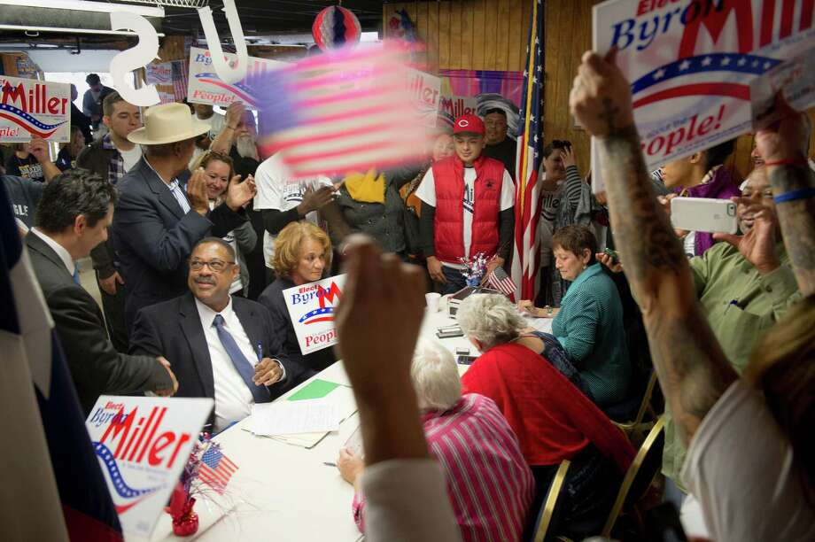 Democrat Byron Miller, second left, fills out the paperwork for his campaign for Texas State Representative 120 at the VFW Post 76 during a Democratic rally as candidates began filing for Bexar county positions on Saturday, November 14, 2015. Photo: Matthew Busch /For The San Antonio Express-News / © Matthew Busch