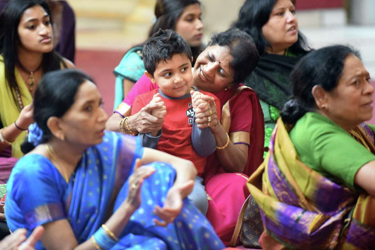 Kiran Amin of Scotia, center, helps her grandson Aryan Patel, 3, clap to the music during the Grand Diwali Celebration on Saturday, Nov. 14, 2015, at the Hindu Temple Society in Loudonville, N.Y. (Cindy Schultz / Times Union)