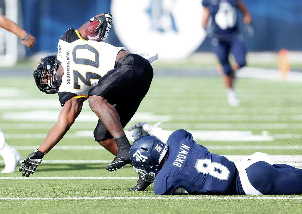 Rice Owls defensive end Derek Brown (8) tries to stop Southern Miss Golden Eagles running back Jalen Richard (30) during the first half of a college football game at Rice Stadium on Saturday, Nov. 14, 2015, in Houston.