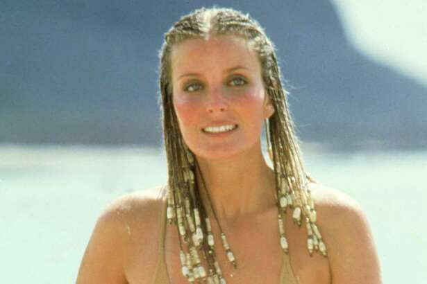 UNSPECIFIED - JULY 27: Medium shot of Bo Derek as Jenny, wearing bathing suit, running on beach.