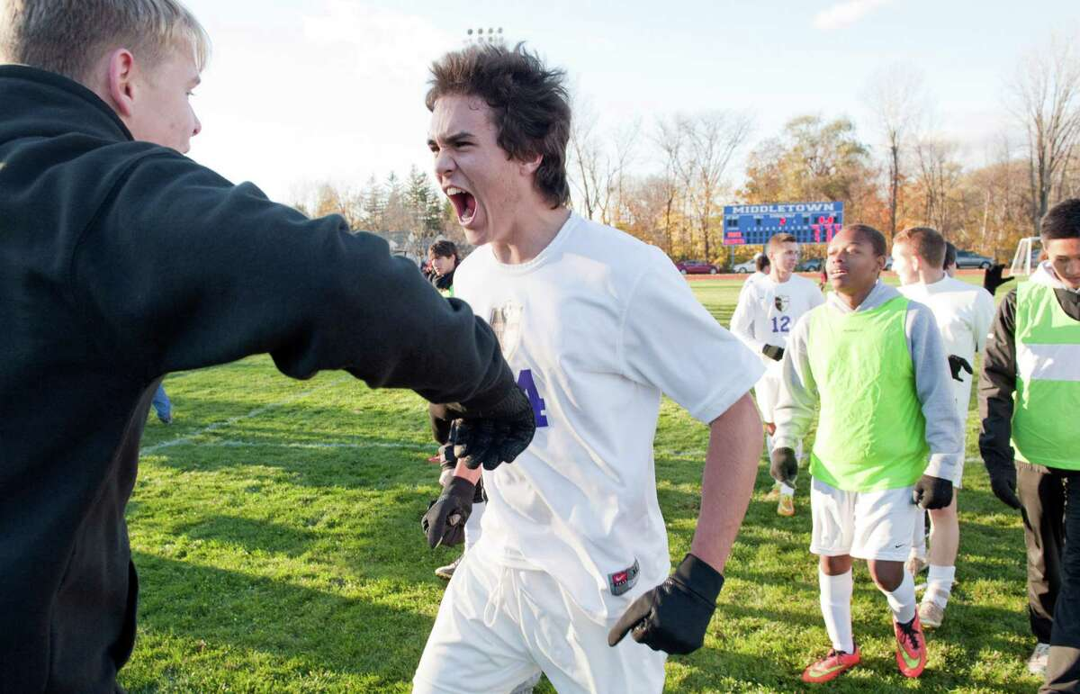 Ballston Spa (#64) Jack Fitzgerald, center, and team mates celebrate after beating Ithaca in the State semifinals, boys' soccer game Saturday November 14, 2015, at Middletown High School in Middletown, N.Y. Photo by Karl Rabe for The Times Union