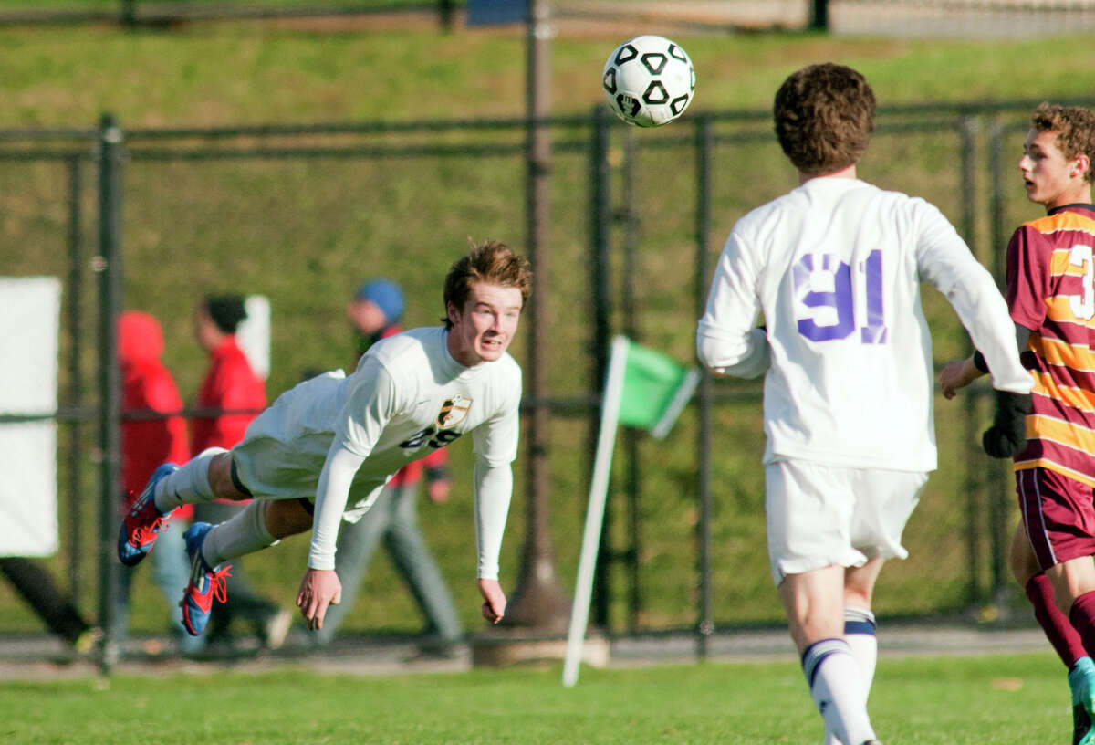 Ballston Spa's Andrew Companion heads the ball during State semifinals, boys' soccer game against Ithaca Saturday November 14, 2015, at Middletown High School in Middletown, N.Y. Photo by Karl Rabe for The Times Union