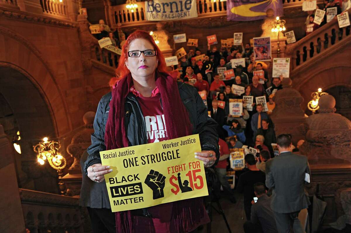 McDonald's worker Jacquie Jordan of Albany is seen at a rally for a $15 minimum wage at the Capitol on Tuesday, Nov. 10, 2015 in Albany, N.Y. Jordan has gone through on-call scheduling at her job. (Lori Van Buren / Times Union)