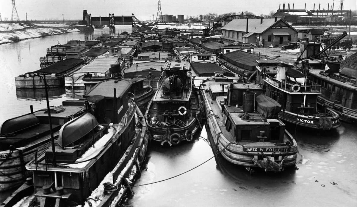 Barges in Albany. Taken March 27, 1937. Fast forward to 2015, the state canal system is scheduled to close for the season on Wednesday, November 18 at 5 p.m. Commercial vessels requiring more time to clear the system can call 461-0942 by Monday. (Times Union Archive)