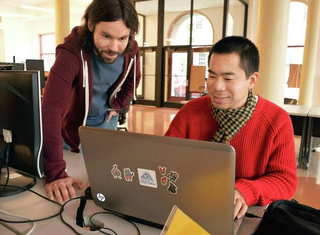 Tech Valley Game Space founder Jamey Stevenson, left, and event coordinator Taro Omiya in their new quarters in the Quackenbush Building Friday Nov. 13, 2015 in Troy, NY.  (John Carl D'Annibale / Times Union) Photo: John Carl D'Annibale / 00034239A