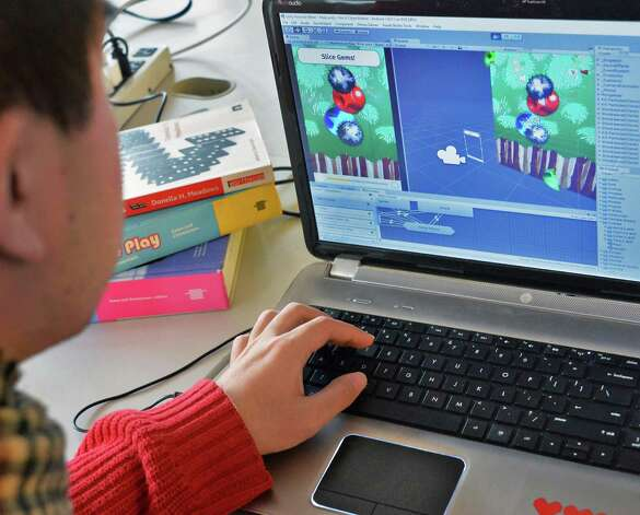 Tech Valley Game Space event coordinator Taro Omiya works on one of his games in their new quarters in the Quackenbush Building Friday Nov. 13, 2015 in Troy, NY.  (John Carl D'Annibale / Times Union) Photo: John Carl D'Annibale / 00034239A