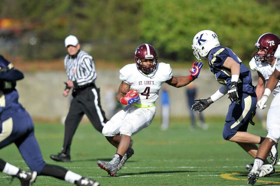 St. Luke's running back Justin Brown makes a cut during the last game of the season at King School on Saturday, Nov. 4, 2015. Photo: Michael Cummo / Hearst Connecticut Media / Stamford Advocate