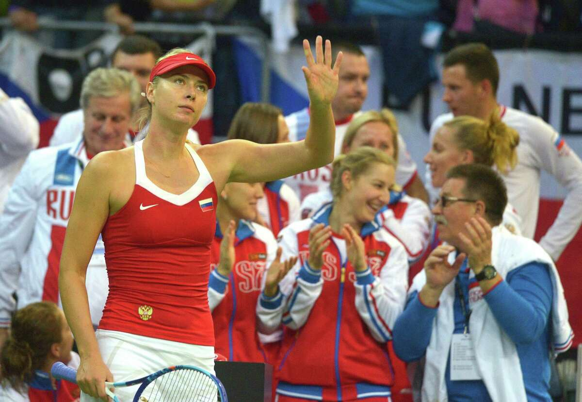 Maria Sharapova of Russia greets fans after her match againts Karolina Pliskova of Czech Republic during the International Tennis Federation Fed Cup final match between Czech Republic and Russia on November 14, 2015 in Prague. AFP PHOTO / MICHAL CIZEKMICHAL CIZEK/AFP/Getty Images ORG XMIT: 9733