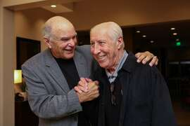Former Raiders quarterback, Daryle Lamonica (left) and former teammate Fred Biletnikoff (right) share a laugh at a fundraiser for the Biletnikoff Foundation at the Marriott Hotel in San Ramon, California on Friday, November 13, 2015.