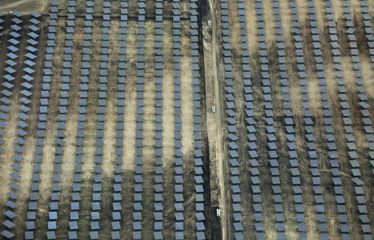 Solar panels are seen at Alamo 5 Solar Farm, owned by Con Edison Development, just outside Uvalde, TX. Friday, Nov. 13, 2015.