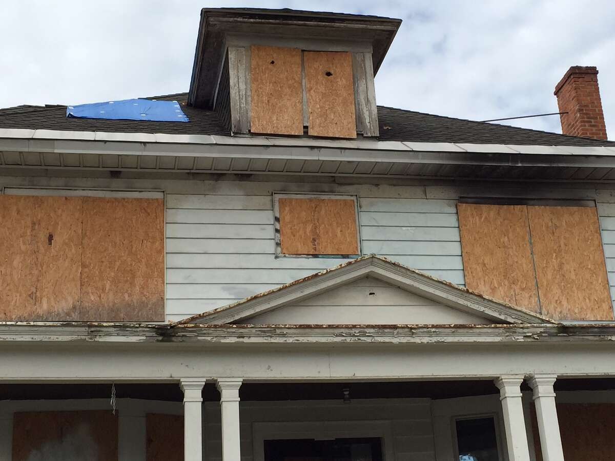 An unsolved suspicious predawn fire on Dec. 2, 2014 caused severe damage of this house at 240 W. Lawrence St. in Albany, used as an outreach center for immigrants and refugees. After an insurance cllaim settlement, a $250,000 restoration will begin this month at the headquarters of Refugee and Immigrant Support Services of Emmaus. (Paul Grondahl / Times Union)