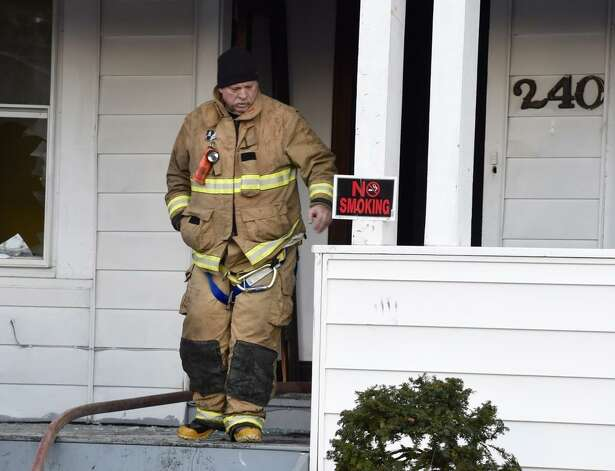 Firefighters remained at the scene Tuesday of an early morning fire that damaged a building on West Lawrence Street Dec. 2, 2014. The fire at 240 W. Lawrence St., was first noticed at about 5 a.m. (Skip Dickstein / Times Union archive)
