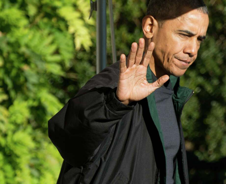 President Barack Obama walks to Marine One on the South Lawn at the White House in Washington, Saturday, Nov. 14, 2015, for a short trip to Andrews Air Force Base to travel to Antalya, Turkey to participate in the G-20 Leaders Summit starting Sunday. Obama begins a nine-day trip to Turkey, Philippines and Malaysia. (AP Photo/Andrew Harnik) Photo: Andrew Harnik, STF / AP