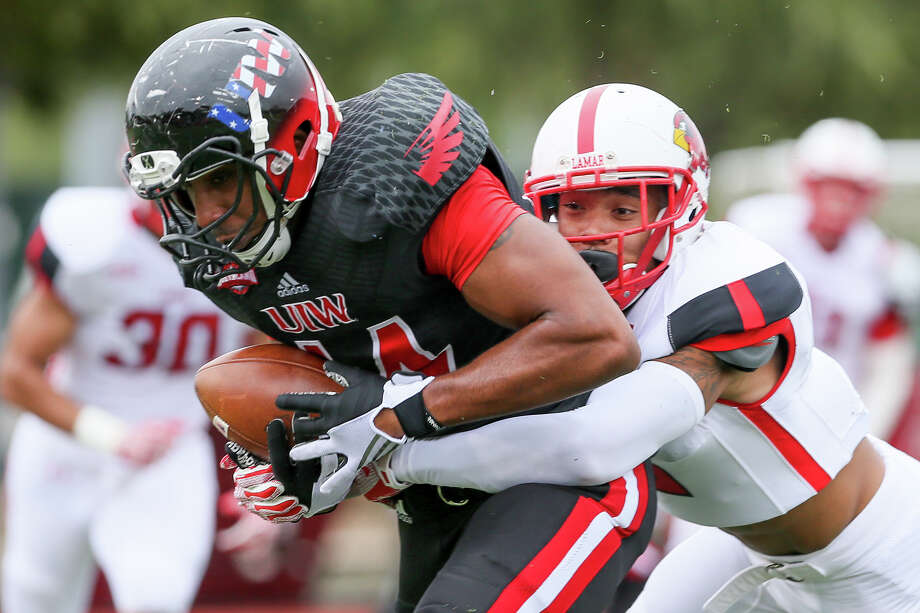 UIW's Cyril Clarke (left) tries to break free from Lamar's Brendan Langley during the first half of their Southland Conference game at Benson Stadium on Saturday, Nov. 14, 2015.  Lamar beat UIW 28-21.  MARVIN PFEIFFER/ mpfeiffer@express-news.net Photo: Marvin Pfeiffer, Staff / San Antonio Express-News / Express-News 2015