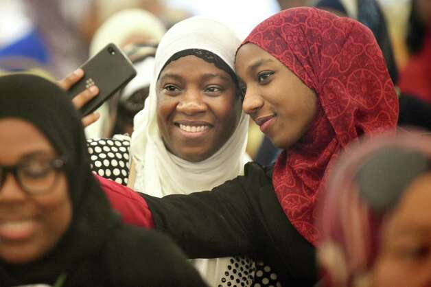 Ayana A. Wahid of Ottawa, Canada, center, and her daughter Malaika Al-Batin of York, S.C.smile for a selfie during the Inaugural International Islamophobia Conference on Saturday, Nov. 14, 2015, at the Muslim Community Center of the Capital District in Colonie, N.Y. (Cindy Schultz / Times Union) Photo: Cindy Schultz / 00034259A