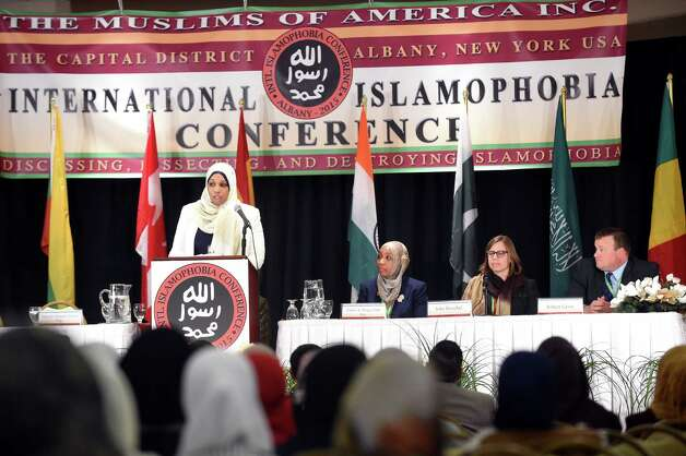 Tahirah Amatul-Wadud, general counsel for The Muslims of America, left, introduces panelists during the Inaugural International Islamophobia Conference on Saturday, Nov. 14, 2015, at the Muslim Community Center of the Capital District in Colonie, N.Y. Panelists, from left, are Tahirah Haqq-Clark, legal counsel to The Muslims of America, Julia Reischel, editor of The Watershed Post, and Robert Gavin, reporter for the Times Union. (Cindy Schultz / Times Union) Photo: Cindy Schultz / 00034259A