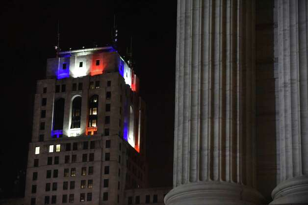As seen from the state education building, the top of the Alfred E. Smith building is lit in the colors of the French flag on Saturday, Nov. 14, 2015, in Albany, N.Y. (Cindy Schultz / Times Union) Photo: Cindy Schultz / 00034259A