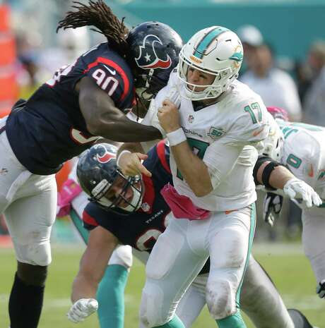 During a respite between numerous injuries that have sidelined him for 13 of his first 24 NFL games, Texans linebacker Jadeveon Clowney, left, got his lone sack against Miami last month. Photo: Brett Coomer, Staff / © 2015  Houston Chronicle