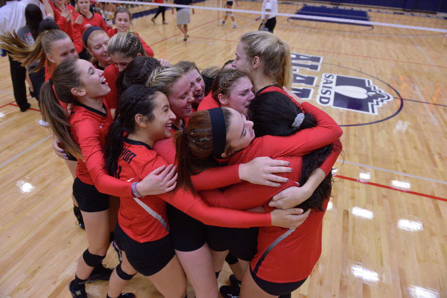 New Braunfels Canyon players hug each other after defeating O'Connor to win rthe U.I.L Region IV  6A volleyball tournament Saturday afternoon. Photo: Robin Jerstad / San Antonio Express-News