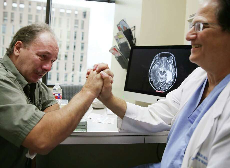 "After Dr. David Baskin shows Matt Futer's latest MRI, the former brain cancer patients says ""I'm having a hard time not crying."" Photo: Elizabeth Conley, Staff / © 2015 Houston Chronicle"