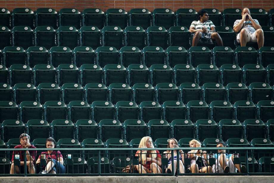 The Astros put their fans through years of misery and saw attendance plummet as a result before rewarding them with the first payoff from their rebuilding with a playoff run in 2015. Photo: Michael Paulsen, Staff / © 2012 Houston Chronicle