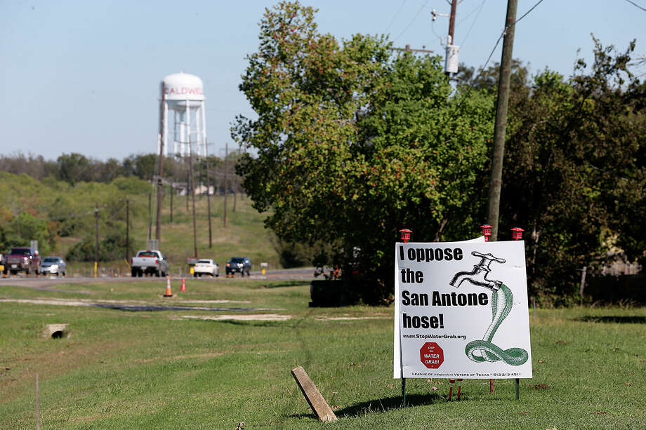 Signs against the proposed San Antonio Water System's Vista Ridge project are seen at a residence along Texas State Highway 21 in Caldwell, Texas, Sunday, Nov. 8, 2015. Caldwell is the Burleson County seat and SAWS plans on piping water from Burleson and Milam counties to San Antonio through their Vista Ridge Project. The multi billion dollar project has drawn objections from area landowners and San Antonio activist. Photo: Jerry Lara /San Antonio Express-News / © 2015 San Antonio Express-News