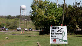 Signs against the proposed San Antonio Water System's Vista Ridge project are seen at a residence along Texas State Highway 21 in Caldwell, Texas, Sunday, Nov. 8, 2015. Caldwell is the Burleson County seat and SAWS plans on piping water from Burleson and Milam counties to San Antonio through their Vista Ridge Project. The multi billion dollar project has drawn objections from area landowners and San Antonio activist.