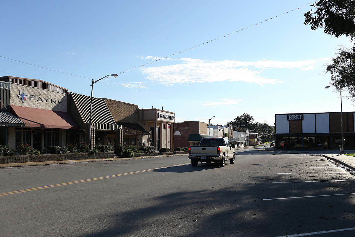With businesses closed on Sundays, traffic is minimal on Main Street in downtown Caldwell on Nov. 8. Some landowners in Burleson County are fighting San Antonio's plans to tap the Carrizo-Wilcox Aquifer here and ship more than 16 billions water to San Antonio via a 142-mile pipeline. Other landowners leased their water rights to the private company involved in the pipeline project.