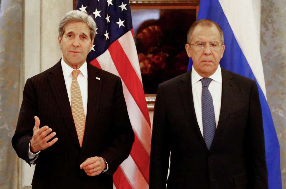 Russia's Foreign Minister Sergey Lavrov, right, and U.S. Secretary of State John Kerry address the media before a meeting in Vienna, Austria, Saturday  Nov.14, 2015. Foreign ministers from more than a dozen nations have begun meeting in Vienna seeking to find a way to resolve the conflict in Syria.   (Leonhard Foeger/Pool Photo via AP) Photo: Leonhard Foeger, POOL / Pool reuters