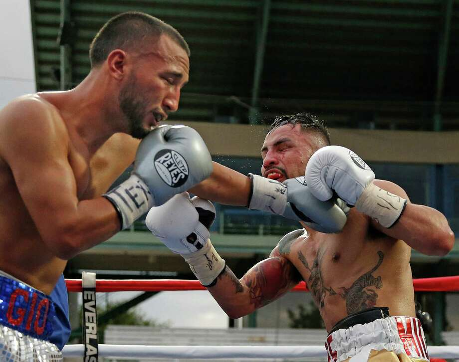 Joseph Rios,R, takes a punch from Felipe Castaneda.  The bout ended in a draw at Wolf Stadium on Saturday, November 14, 3015. Photo: Ron Cortes, Photographer / For The San Anton / Express-News