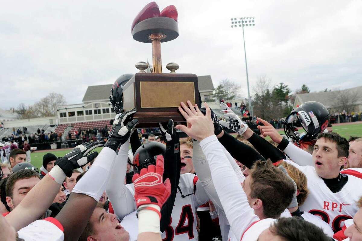 Rensselaer Polytechnic Institute players celebrate with the Dutchman Shoes trophy after a 23-10 win against Union during an NCAA college football game on Saturday, Nov. 14, 2015, in Schenectady, N.Y. (Hans Pennink / Special to the Times Union) ORG XMIT: HP121
