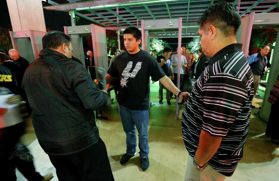 Adrian Gallegos is checked by security before he enters the AT&T Center to watch the Spurs. Photo: Kin Man Hui / San Antonio Express-News / ©2015 San Antonio Express-News