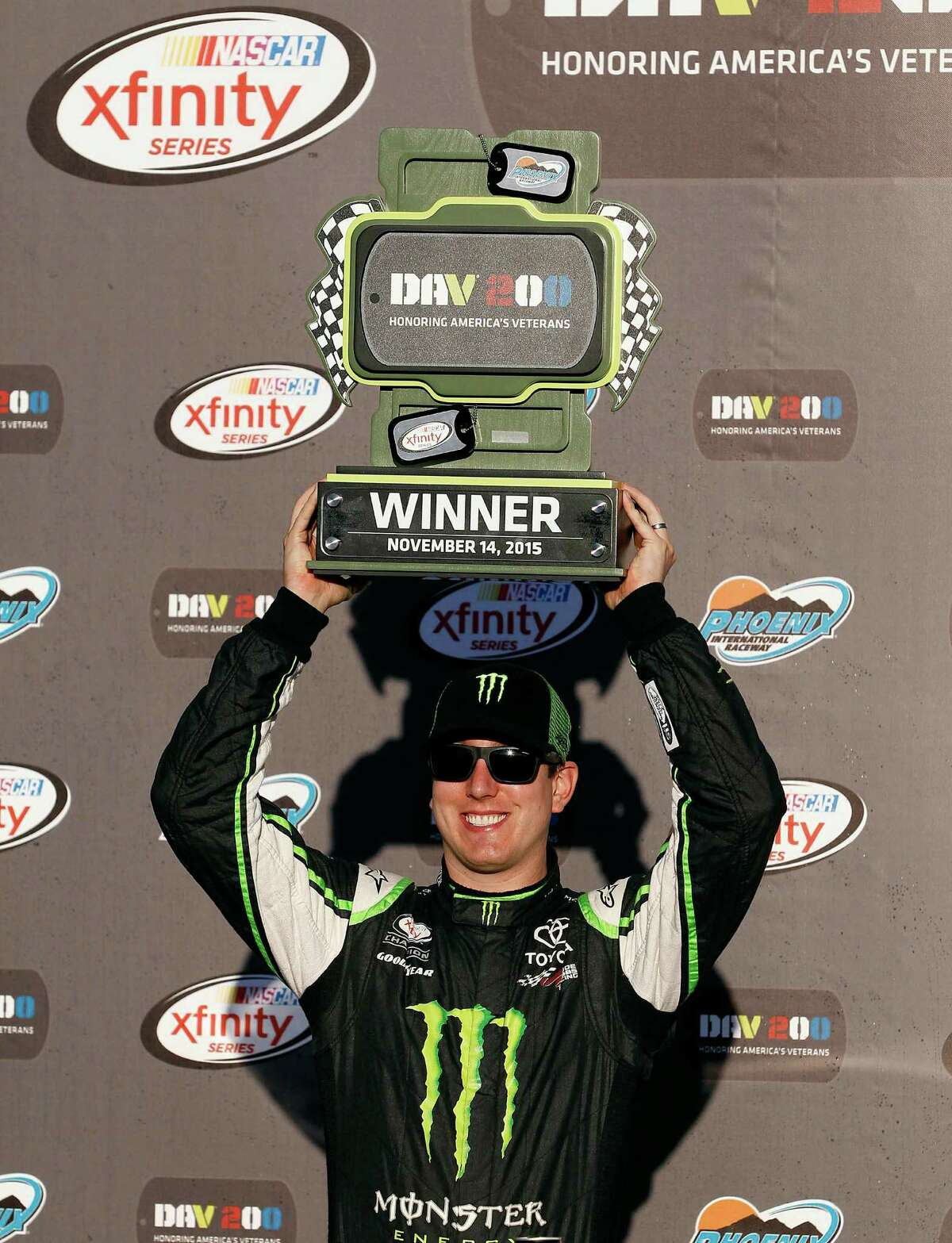 Kyle Busch celebrates in Victory Lane after winning the NASCAR Xfinity Series auto race at Phoenix International Raceway, Saturday, Nov. 14, 2015, in Avondale, Ariz. (AP Photo/Ralph Freso) ORG XMIT: AZRF216