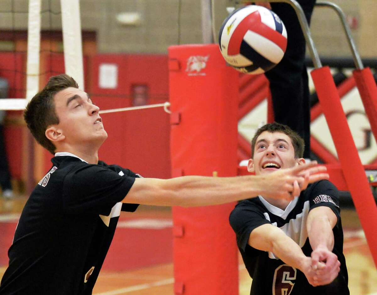 Burnt Hills's #5 Ben Pelton, left, and #6 Brad Albright in action during Saturday's volleyball regional final against Oswego Nov. 14, 2015 in Guilderland, NY. (John Carl D'Annibale / Times Union)